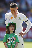 Michael Clarke wipes away tears during the tribute to the late Phillip Hughes during day one of the First Test match between Australia and India at...