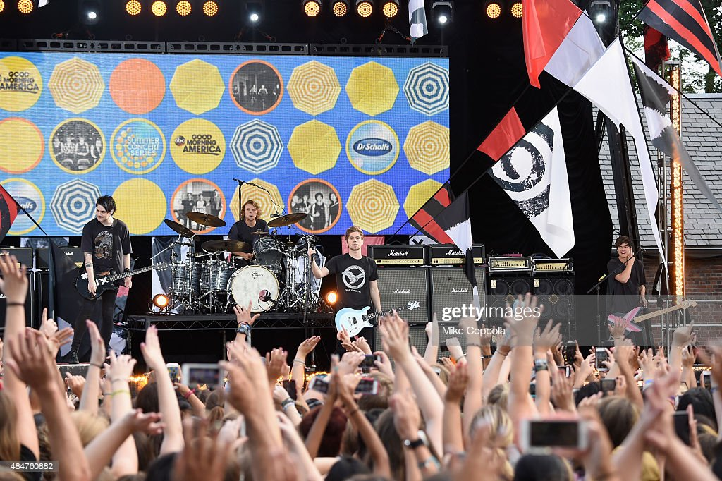 Michael Clifford, Ashton Irwin, Luke Hemmings, and Calum Hood of 5 Seconds Of Summer Perform on ABC's 'Good Morning America' at Rumsey Playfield, Central Park on August 21, 2015 in New York City.