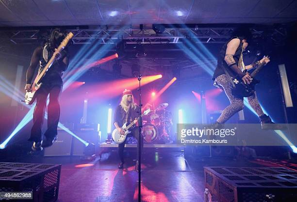 Michael Clifford Ashton Irwin Luke Hemmings and Calum Hood of 5 Seconds of Summer perform at the iHeartRadio Halloween LIVE event at the iHeartRadio...