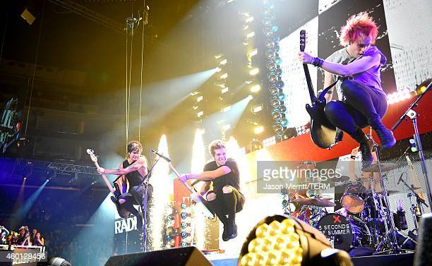 MIchael Clifford Luke Hemmings Ashton Irwin and Calum Hood of 5 Seconds of Summer perform during KIIS FM's Jingle Ball 2014 Powered by LINE at...