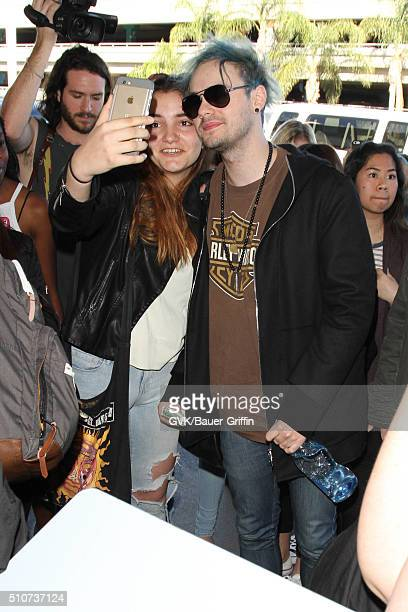 Michael Clifford of 5 Seconds of Summer is seen at LAX on February 16 2016 in Los Angeles California