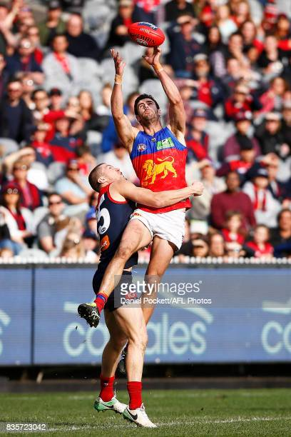 Michael Close of the Lions and Tom McDonald of the Demons contest the ball during the round 22 AFL match between the Melbourne Demons and the...