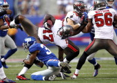Michael Coe of the New York Giants takes down Arrelious Benn of the Tampa Bay Buccaneers during a game at MetLife Stadium on September 16 2012 in...