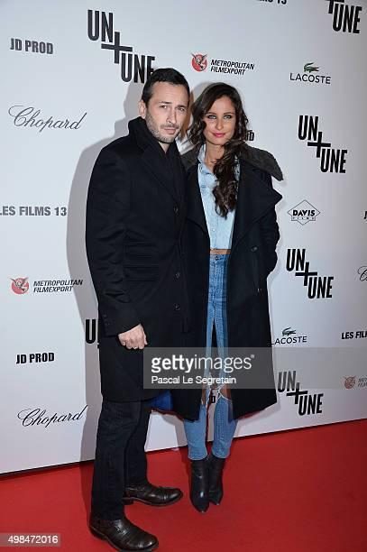 Michael Cohen and Malika Menard attend The 'Un Une' Paris Premiere At Cinema UGC Normandie on November 23 2015 in Paris France