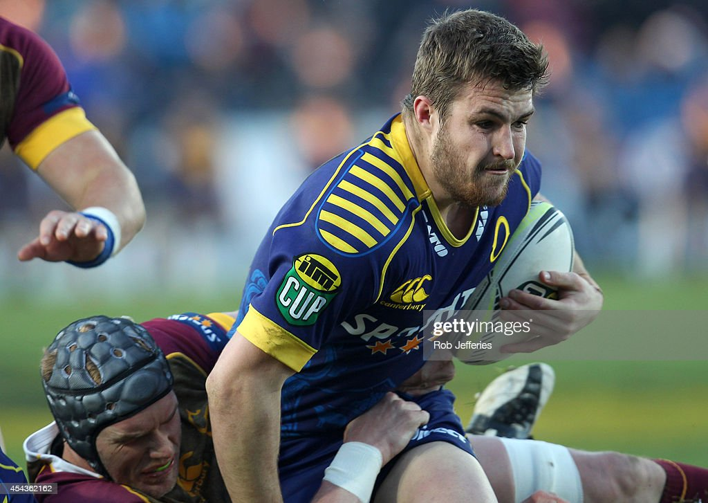 Michael Collins of Otago is tackled by Josh Bekhuis of Southland during the ITM Cup match between Southland and Otago on August 30, 2014 in Invercargill, New Zealand.
