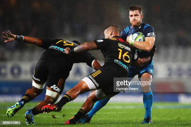Michael Collins of the Blues charges forward during the round 14 Super Rugby match between the Blues and the Chiefs and Eden Park on May 26 2017 in...