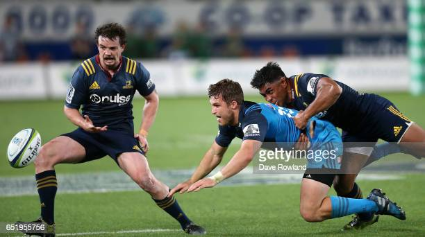 Michael Collins of the Blues is tackled by Malakai Fekitoa of the Highlanders during the round three Super Rugby match between the Blues and the...