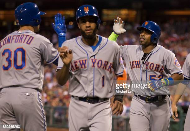 Michael Conforto Amed Rosario and Yoenis Cespedes of the New York Mets celebrate after a three run home run hit by Cespedes in the top of the third...