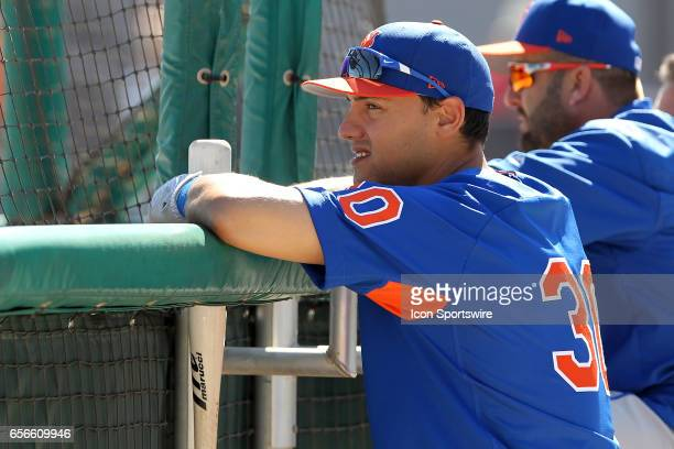 Michael Conforto of the Mets watches batting practice before the spring training game between the New York Mets and the Detroit Tigers on March 20...