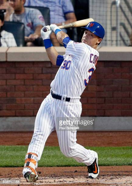 Michael Conforto of the New York Mets bats during an interleague MLB baseball game against the New York Yankees on August 17 2017 at CitiField in the...