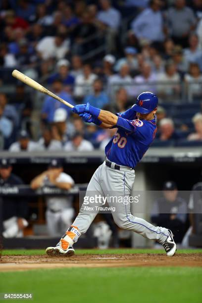 Michael Conforto of the New York Mets bats during the game against the New York Yankees at Yankee Stadium on Monday August 14 2017 in the Bronx...