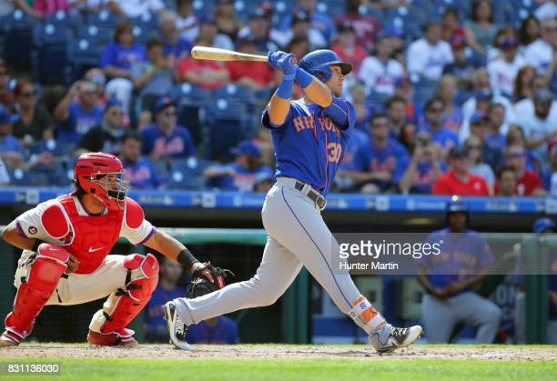Michael Conforto of the New York Mets bats in the seventh inning during a game against the Philadelphia Phillies at Citizens Bank Park on August 13...