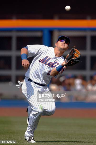 Michael Conforto of the New York Mets catches a fly ball in an MLB baseball game against the Miami Marlins on August 20 2017 at CitiField in the...