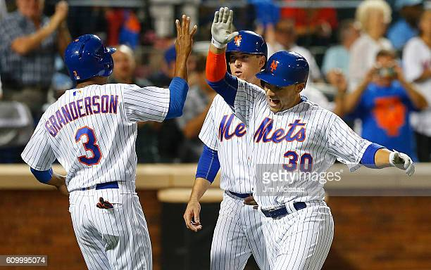 Michael Conforto of the New York Mets celebrates his fifth inning three run home run against the Philadelphia Phillies with teammates Curtis...