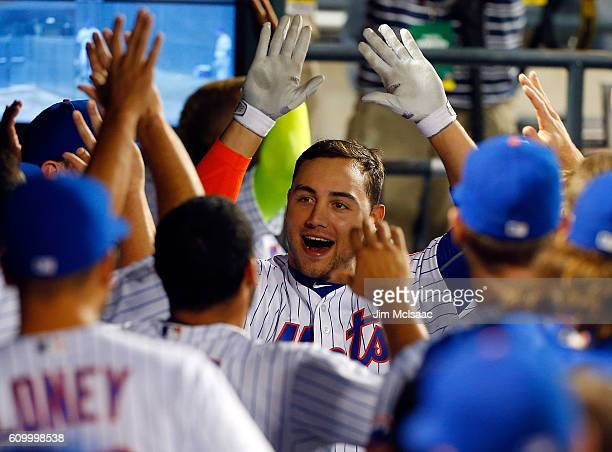Michael Conforto of the New York Mets celebrates his fifth inning threerun home run against the Philadelphia Phillies at Citi Field on September 23...