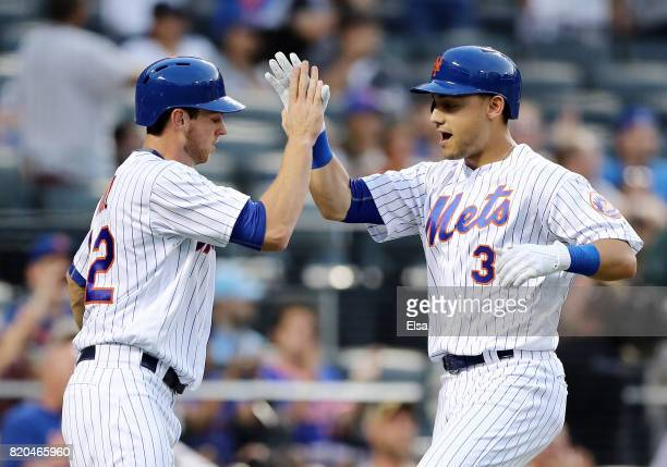 Michael Conforto of the New York Mets celebrates his two run home run with teammate Steven Matz in the third inning against the Oakland Athletics on...