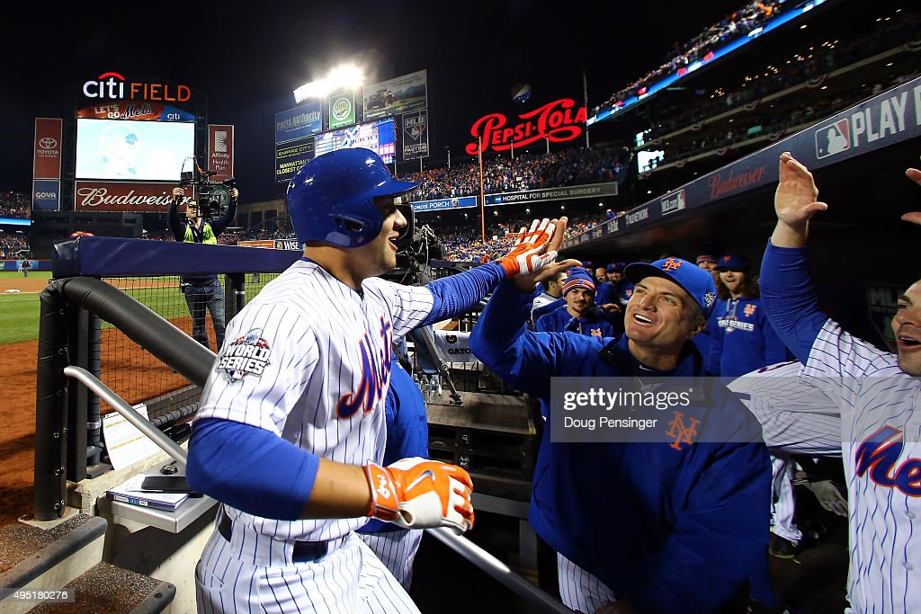 <a gi-track='captionPersonalityLinkClicked' href=/galleries/search?phrase=Michael+Conforto&family=editorial&specificpeople=14076889 ng-click='$event.stopPropagation()'>Michael Conforto</a> #30 of the New York Mets celebrates in the dugout after hitting a solo home run in the fifth inning against <a gi-track='captionPersonalityLinkClicked' href=/galleries/search?phrase=Danny+Duffy&family=editorial&specificpeople=5971971 ng-click='$event.stopPropagation()'>Danny Duffy</a> #41 of the Kansas City Royals during Game Four of the 2015 World Series at Citi Field on October 31, 2015 in the Flushing neighborhood of the Queens borough of New York City.