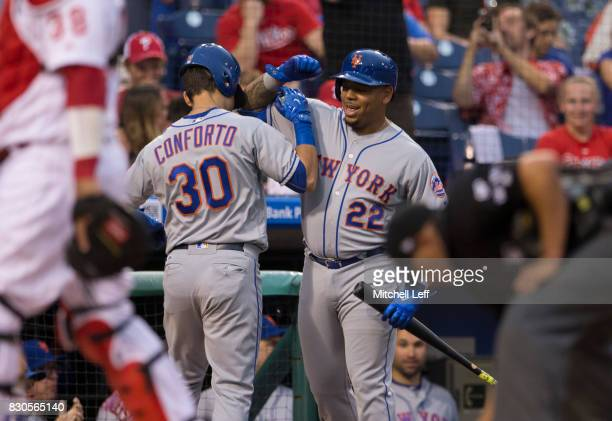 Michael Conforto of the New York Mets celebrates with Dominic Smith after hitting a solo home run in the top of the second inning against the...
