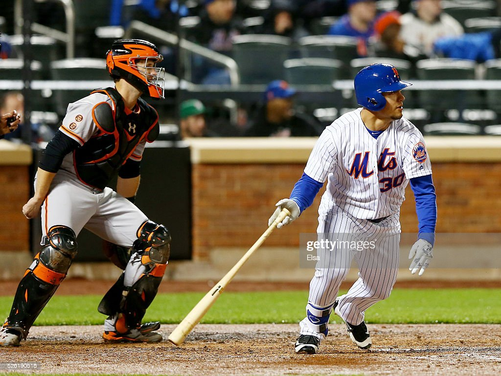 <a gi-track='captionPersonalityLinkClicked' href=/galleries/search?phrase=Michael+Conforto&family=editorial&specificpeople=14076889 ng-click='$event.stopPropagation()'>Michael Conforto</a> #30 of the New York Mets drives in a run in the third inning as <a gi-track='captionPersonalityLinkClicked' href=/galleries/search?phrase=Buster+Posey&family=editorial&specificpeople=4896435 ng-click='$event.stopPropagation()'>Buster Posey</a> #28 of the San Francisco Giants defends at Citi Field on April 29, 2016 in the Flushing neighborhood of the Queens borough of New York City.