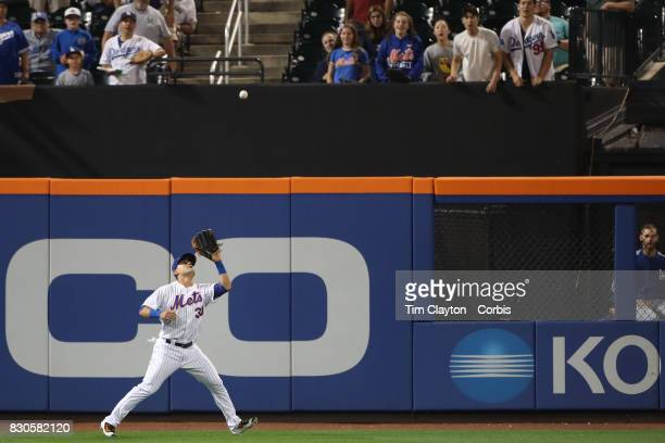 Michael Conforto of the New York Mets making an out at center field during the Los Angeles Dodgers Vs New York Mets regular season MLB game at Citi...