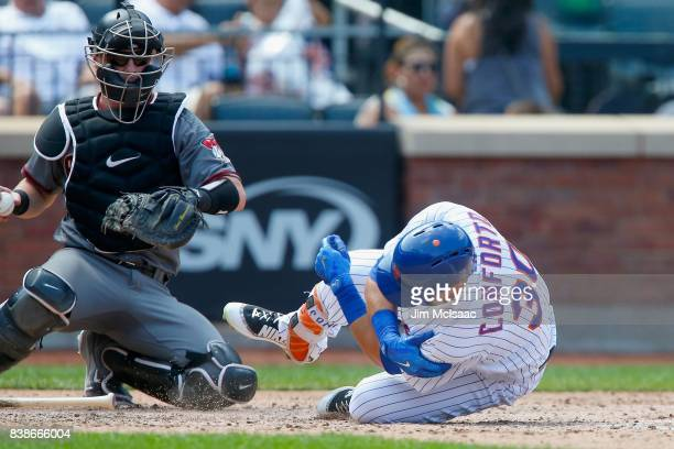 Michael Conforto of the New York Mets reacts after suffering an injury during an atbat during the fifth inning against the Arizona Diamondbacks at...