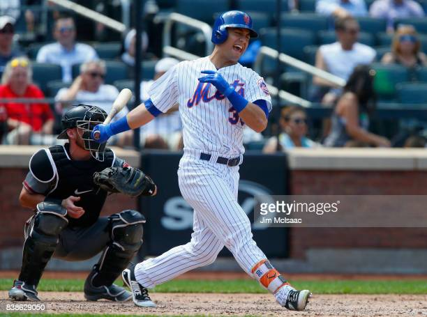 Michael Conforto of the New York Mets reacts after suffering an injury during his swing of an atbat during the fifth inning against the Arizona...
