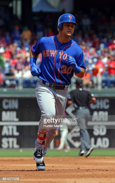 Michael Conforto of the New York Mets rounds the bases after hitting a tworun home run in the first inning during a game against the Philadelphia...
