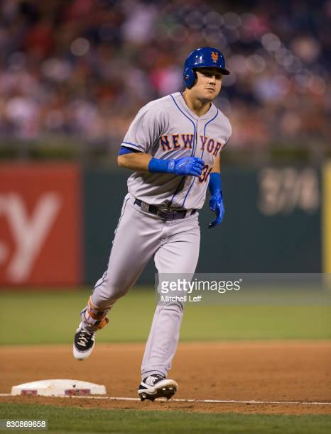 Michael Conforto of the New York Mets rounds third base after hitting a three run home run in the top of the seventh inning against the Philadelphia...