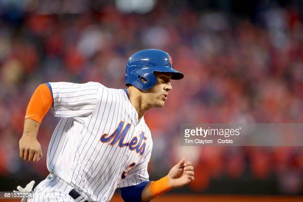 Michael Conforto of the New York Mets rounds third to score on a TJ Rivera of the New York Mets double in the second inning during the San Francisco...