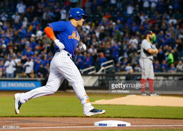 Michael Conforto of the New York Mets runs the bases after his first inning home run against Tanner Roark of the Washington Nationals at Citi Field...