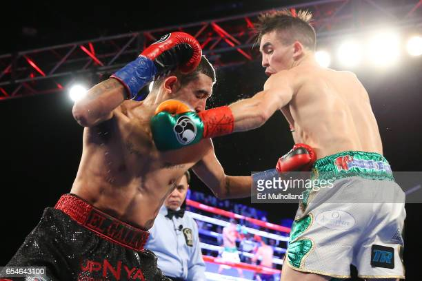 Michael Conlan and Tim Ibarra trade punches during their super bantamweight bout at The Theater at Madison Square Garden on March 17 2017 in New York...