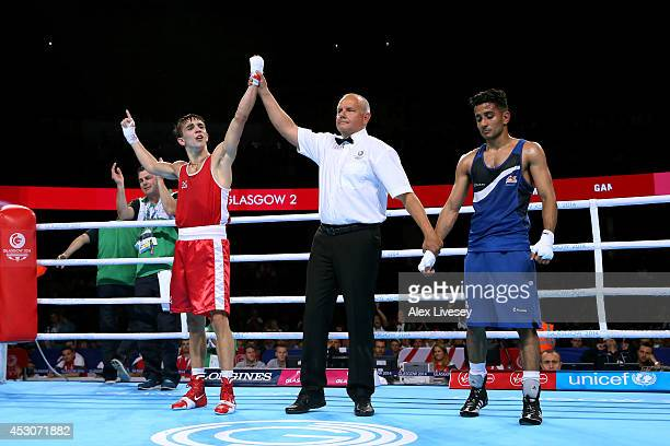 Michael Conlan of Northern Ireland celebrates winning the gold medal against Qais Ashfaq of England during the Men's Bantam Final at SSE Hydro during...