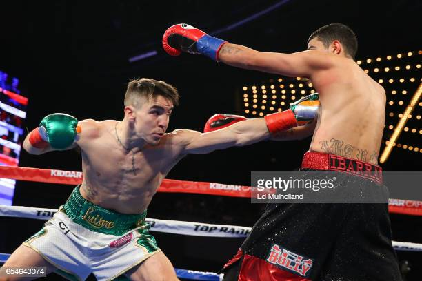 Michael Conlan throws a left jab to the body of Tim Ibarra during their super bantamweight bout at The Theater at Madison Square Garden on March 17...