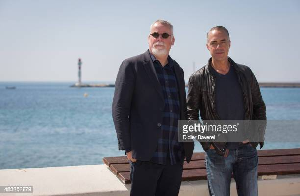 Michael Connelly and Titus Welliver pose during the photocall of 'Bosch' at MIPTV 2014 at Hotel Majestic on April 7 2014 in Cannes France