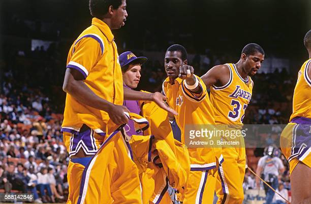 Michael Cooper and AC Green of the Los Angeles Lakers high five before a game circa 1988 at The Forum in Los Angeles California NOTE TO USER User...