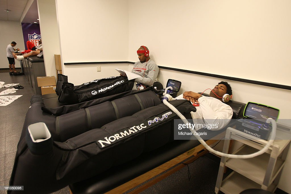 Michael Crabtree #15 and Donte Whitner #31 of the San Francisco 49ers refresh their legs with a Normatec treatment in the locker room prior to Super Bowl XLVII against the Baltimore Ravens at the Mercedes-Benz Superdome on February 3, 2013 in New Orleans, Louisiana. The Ravens won 34-31.