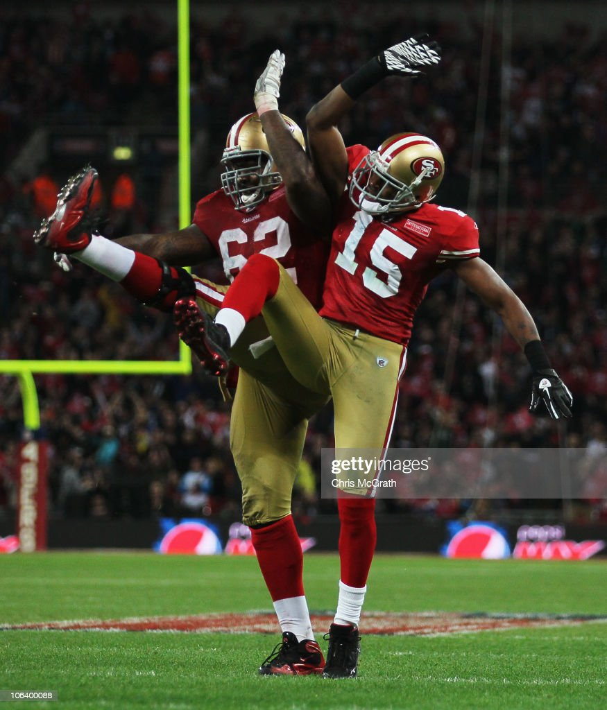 Michael Crabtree of San Francisco 49ers celebrates with Chilo Rachal as he scores their second touchdown during the NFL International Series match...