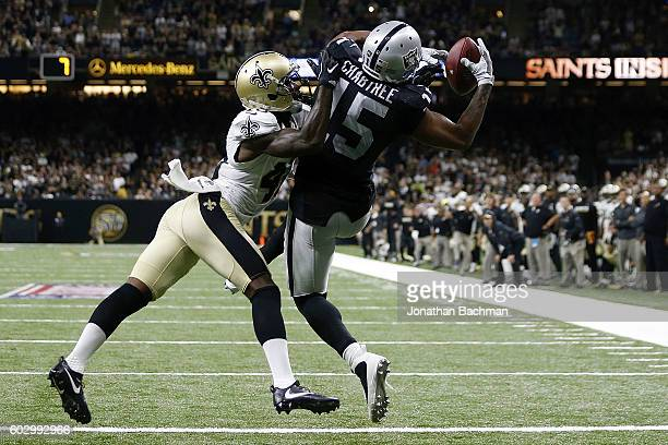 Michael Crabtree of the Oakland Raiders catches a pass over Delvin Breaux of the New Orleans Saints completing a twopoint conversion to take the lead...