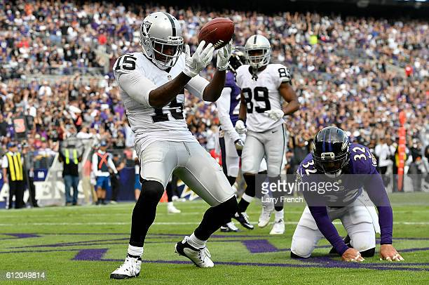 Michael Crabtree of the Oakland Raiders celebrates after scoring a touchdown in the fourth quarter against the Baltimore Ravens at MT Bank Stadium on...