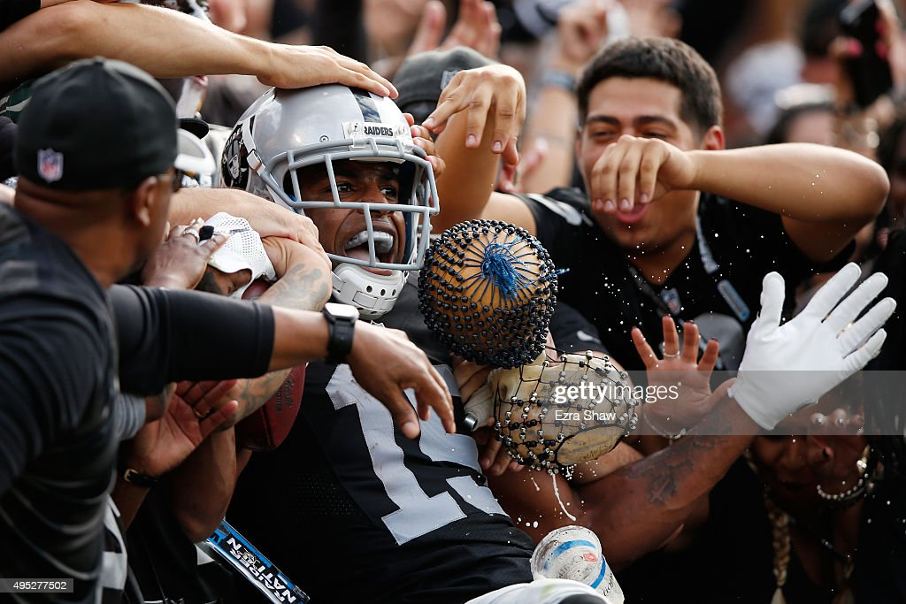 <a gi-track='captionPersonalityLinkClicked' href=/galleries/search?phrase=Michael+Crabtree&family=editorial&specificpeople=4650635 ng-click='$event.stopPropagation()'>Michael Crabtree</a> #15 of the Oakland Raiders celebrates with fans after a 36-yard touchdown against the New York Jets during their NFL game at O.co Coliseum on November 1, 2015 in Oakland, California.