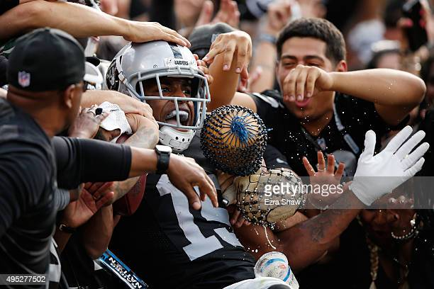 Michael Crabtree of the Oakland Raiders celebrates with fans after a 36yard touchdown against the New York Jets during their NFL game at Oco Coliseum...