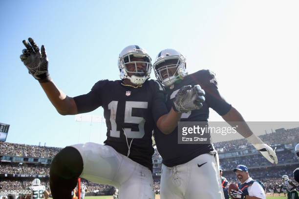 Michael Crabtree of the Oakland Raiders celebrates with Marshall Newhouse and he Crabtree scored a touchdown against the New York Jets at...