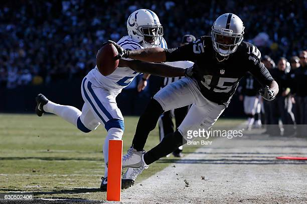 Michael Crabtree of the Oakland Raiders dives short of the goal line during their NFL game against the Indianapolis Colts at Oakland Alameda Coliseum...