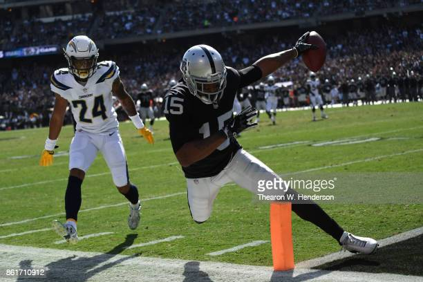 Michael Crabtree of the Oakland Raiders scores a touchdown against the Los Angeles Chargers during their NFL game at OaklandAlameda County Coliseum...