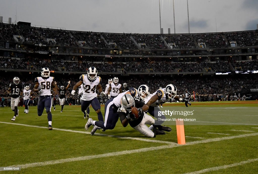 Michael Crabtree #15 of the Oakland Raiders scores on a thirteen yard pass play against the Los Angeles Rams during the second quarter of their preseason NFL football game at Oakland-Alameda County Coliseum on August 19, 2017 in Oakland, California.
