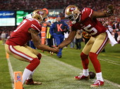Michael Crabtree of the San Francisco 49ers and Colin Kaepernick of the San Francisco 49ers celebrate Crabtree's third quarter touchdown against the...