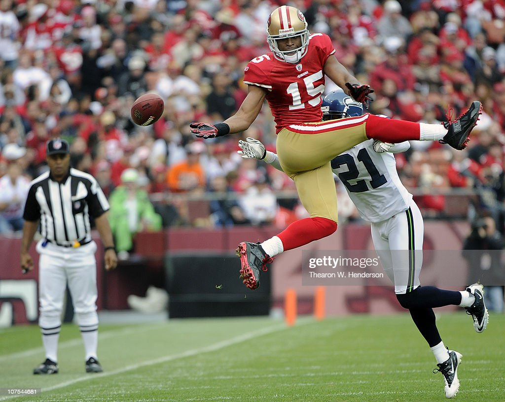 Michael Crabtree of the San Francisco 49ers cant hold on to this pass in front of Kelly Jennings of the Seattle Seahawks during an NFL football game...