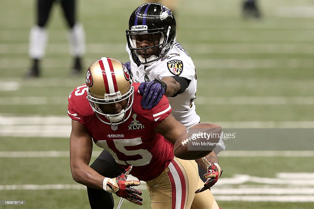 Michael Crabtree #15 of the San Francisco 49ers can't make a catch against Corey Graham #24 of the Baltimore Ravens during Super Bowl XLVII at the Mercedes-Benz Superdome on February 3, 2013 in New Orleans, Louisiana.