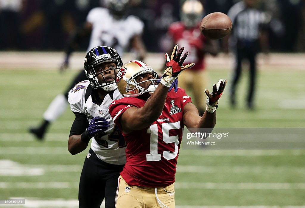 Michael Crabtree #15 of the San Francisco 49ers can't make a catch on a pass attempt in the third quarter against Corey Graham #24 of the Baltimore Ravens during Super Bowl XLVII at the Mercedes-Benz Superdome on February 3, 2013 in New Orleans, Louisiana.