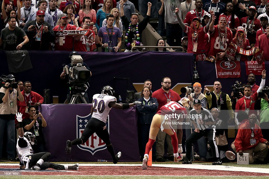 Michael Crabtree #15 of the San Francisco 49ers can't make a catch on a fourth down play in the final two minutes of the fourth quarter against Ed Reed #20, Jimmy Smith #22 of the Baltimore Ravens during Super Bowl XLVII at the Mercedes-Benz Superdome on February 3, 2013 in New Orleans, Louisiana. The Ravens won 34-31.